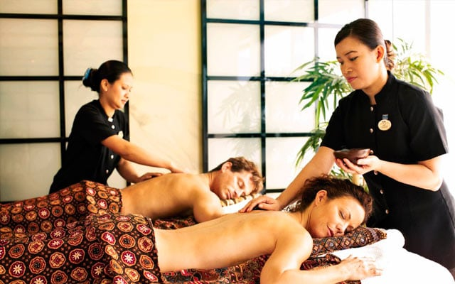 A couple getting a massage in the spa