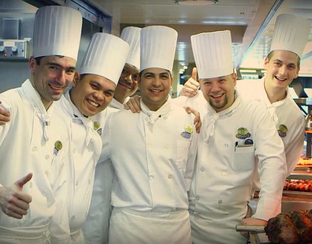 Group of kitchen staff giving thumbs up