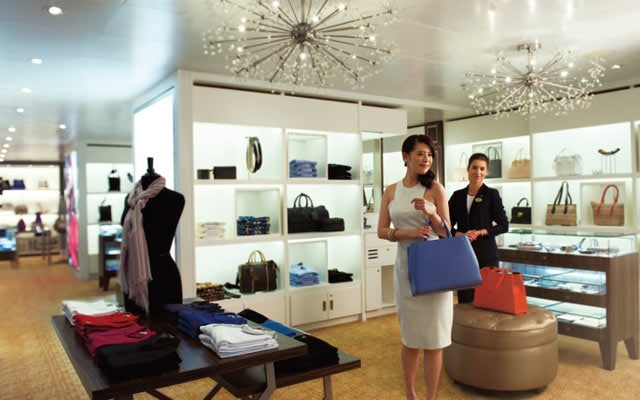Woman shopping in boutique for purses