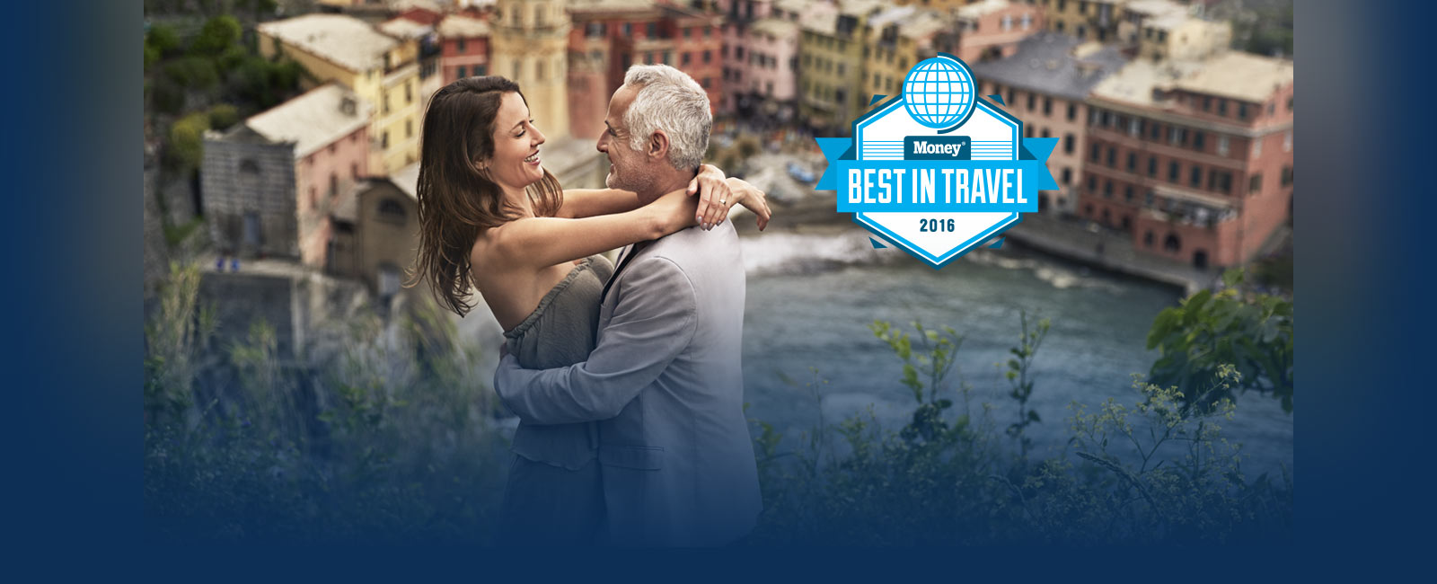 Best in Travel 2016 award from Money. Couple embracing with seaside Italian Village as their backdrop.