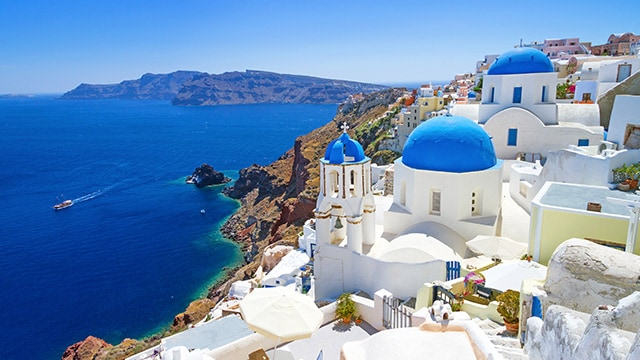 A cliffside view of Santorini overlooking the sea