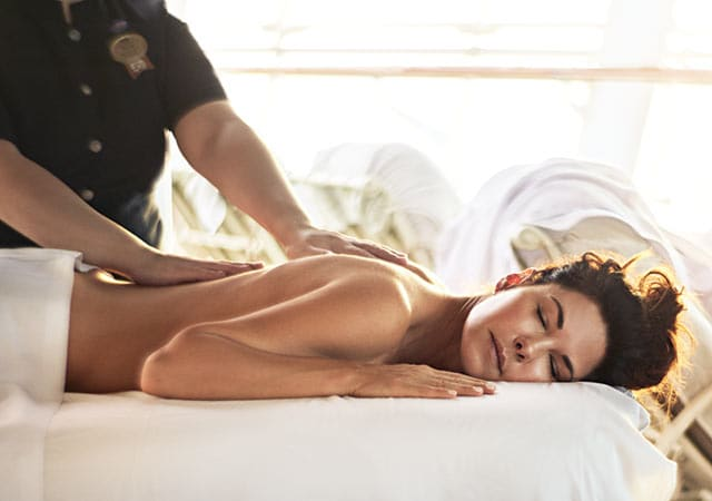 A woman relaxes as she receives a massage