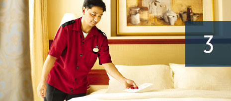 3 - housekeeping staff making bed