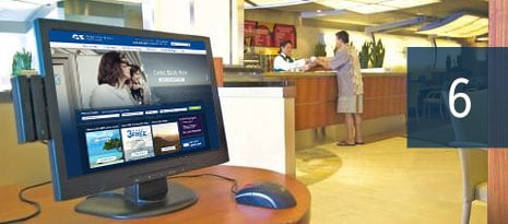 6 - desktop computer monitor setup on a desk, displaying the princess cruises web site