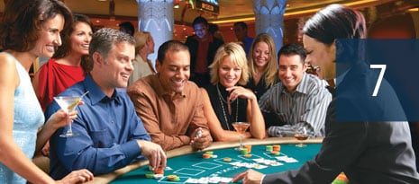 7 - group of people enjoying the casino while playing a card game