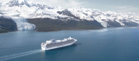 princess cruises cruise ship at sea, sailing past glaciers and mountains in Alaska.