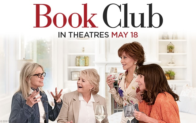 4 women having wine and a lively conversation. Book Club in theatres May 18.