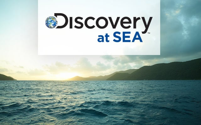 Discovery at Sea logo, view of open water with seaside bluffs to left and right
