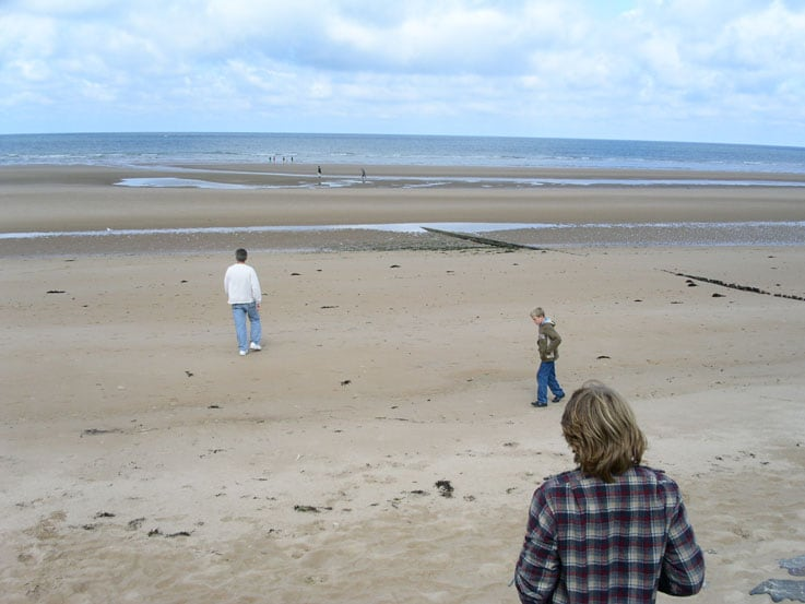 Bruce and his sons exploring a Normandy beach