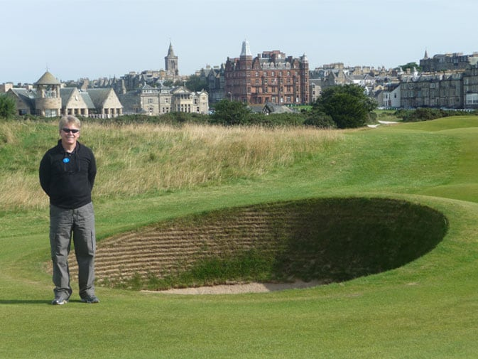 Brad poses in front of one of many pot bunkers in the Road Hole