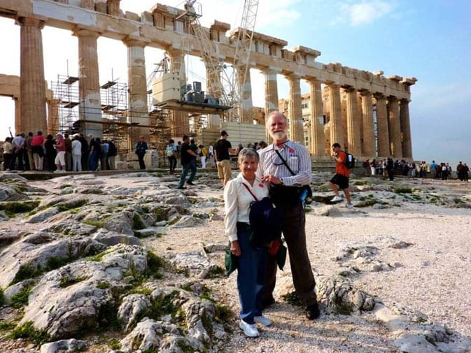 Robert and his wife, Yoli, in front of the Parthenon