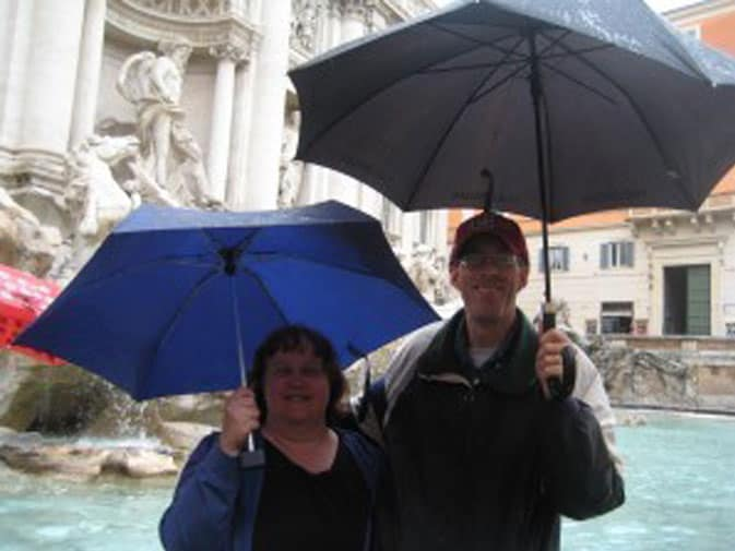 Rain or shine, Donna and her husband, Bill, pose in front of Rome's Trevi Fountain