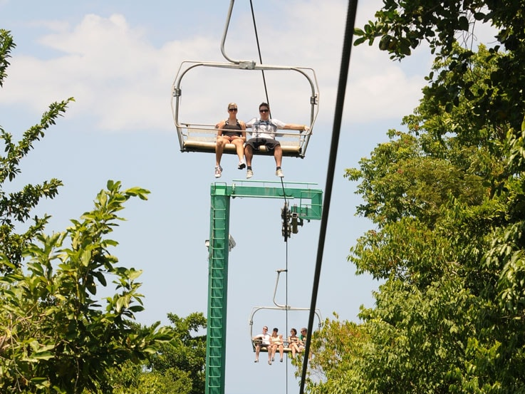 Chairlifts carry bobsledders atop Mystic Mountain