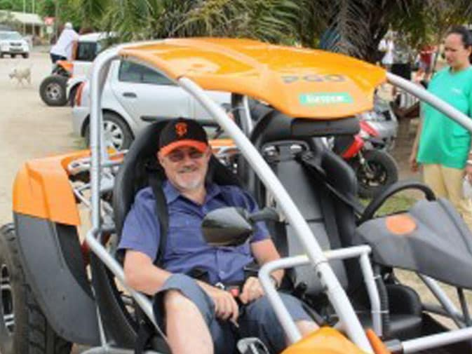 Chris is all smiles in his ride in Moorea