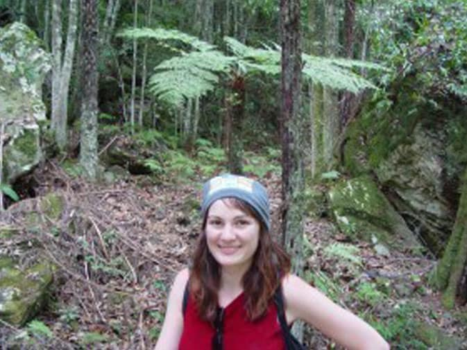 Tracy, smiling, suvived the night in one of Syndey's rainforests