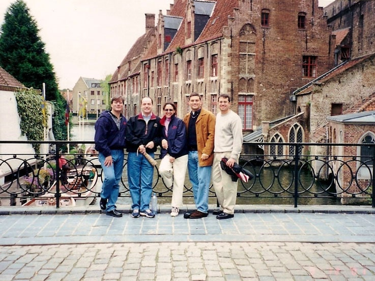 Anthony, right, with his friends on a bridge in Bruges