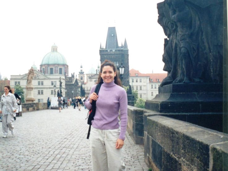 Cindy standing on the Charles Bridge