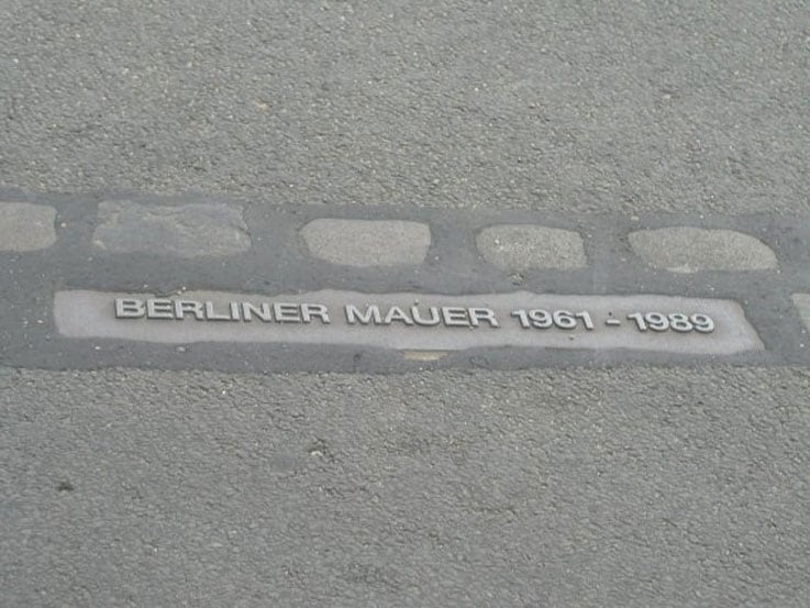Close up view of the wall markers that run through Berlin