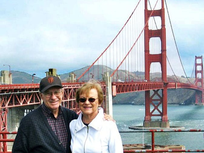 Don and his wife, Jean, pose in front of the Golden Gate Bridge