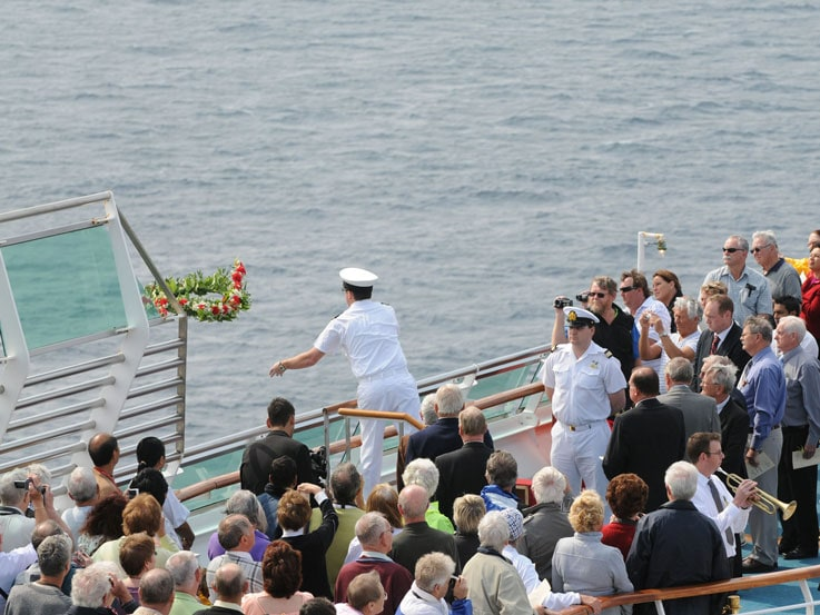 The ceremonial laying of a wreath in the water
