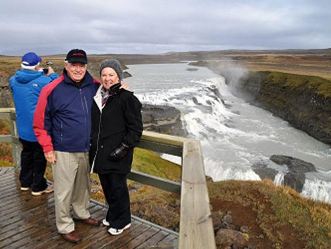 Cindy and her husband, Chet, at Gullfoss Waterfall in Iceland