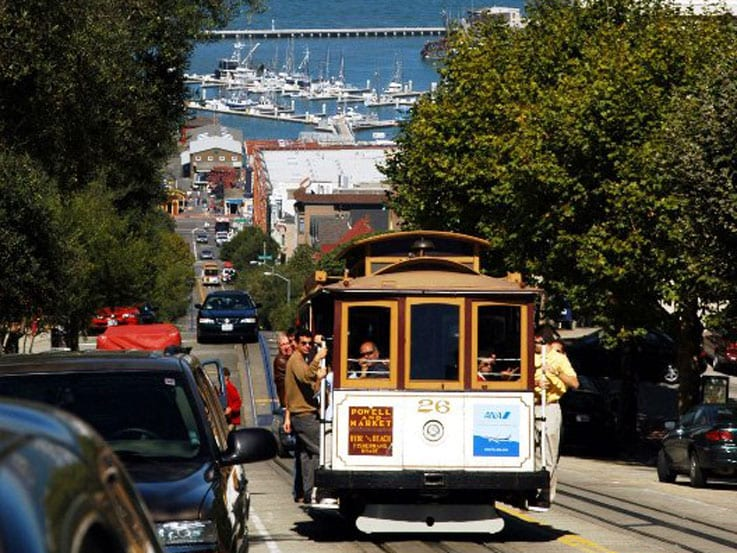 A San Francisco cable car with Alcatraz in the background