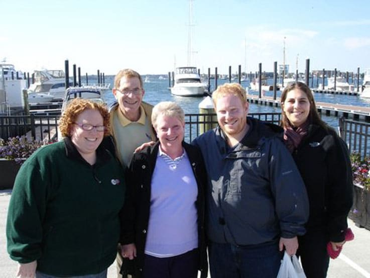 Sheryl (center) surrounded by family in Newport, Rhode Island
