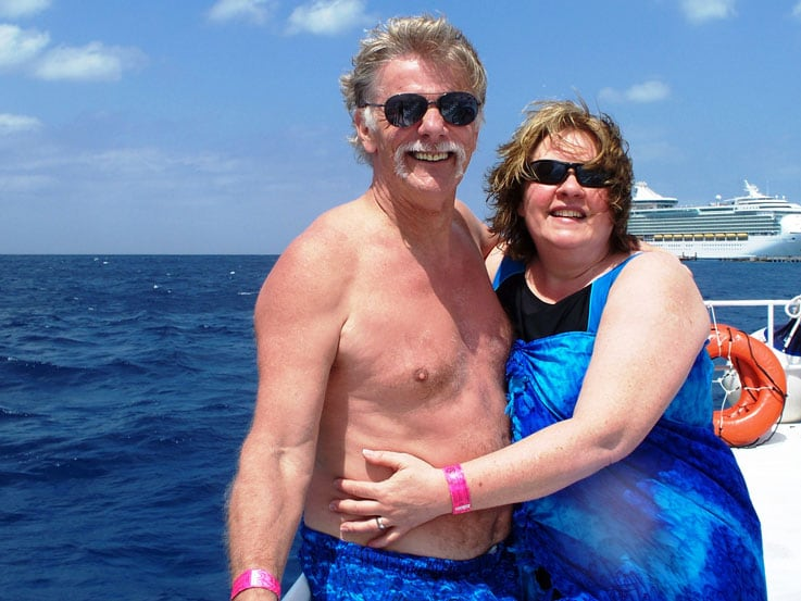 Susan and her husband, Mick, enjoying the sun on a recent cruise