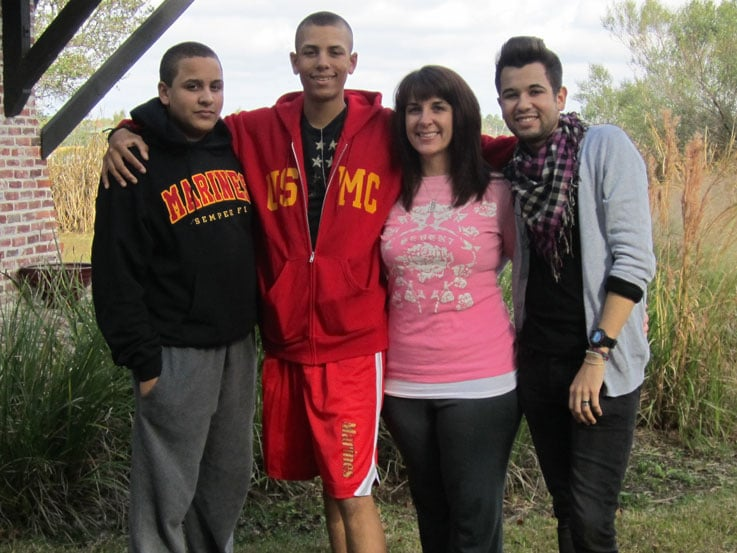 Beth and her sons, Collen (left), Ryan (center) and Kyle (right)
