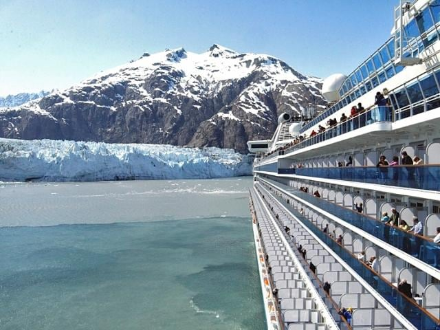 Cruise passengers taking photos of Glacier Bay from their cabin's balcony on a Princess Cruise.