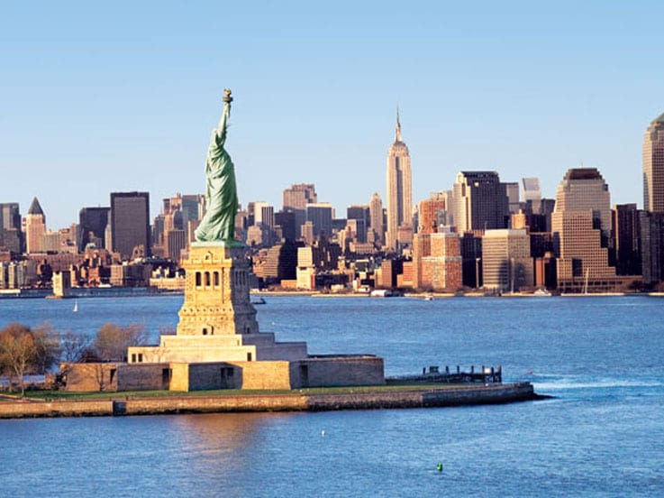 See The Statue Of Liberty And Ellis Island On A Trip To