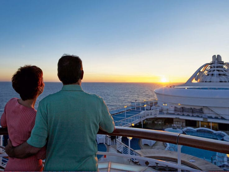Couples on deck watching a sunset