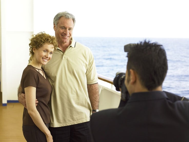 Couple getting picture taken by photographer