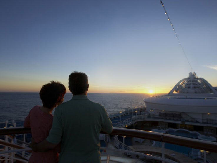 Couple on deck watching the sunset