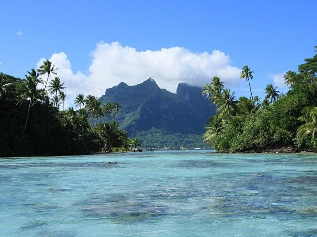 A body of water surrounded by lush vegetation off an island in French Polynesia.