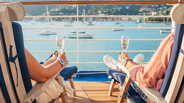 Couple with champagne lounging overlooking the port