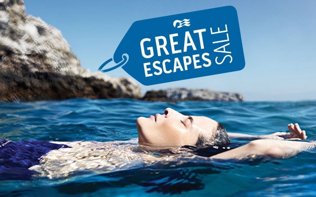 Great Escapes Sale. Woman swimming in the ocean