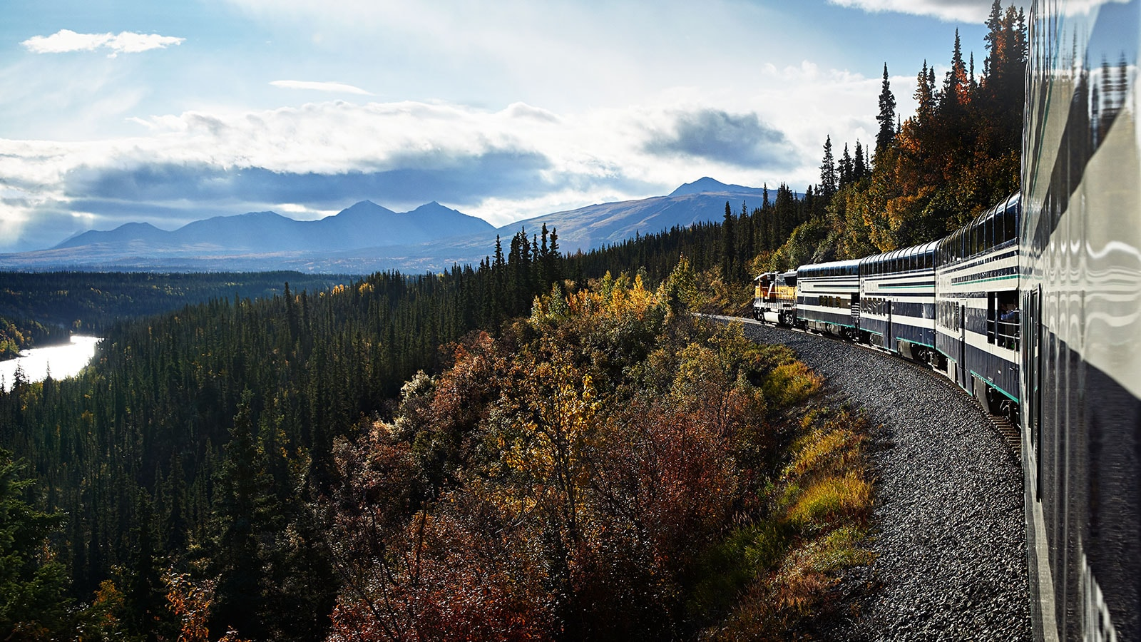 Train travelling through the Alaska wilderness