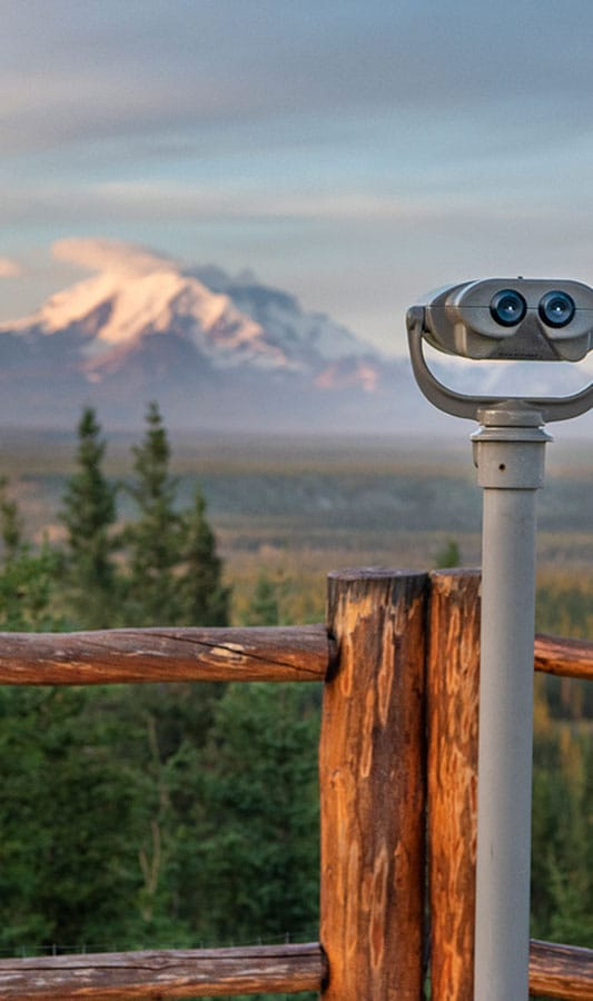 Viewing Binoculars overlooking Wrangell-St. Elias National Park at Copper River Princess Wilderness Lodge