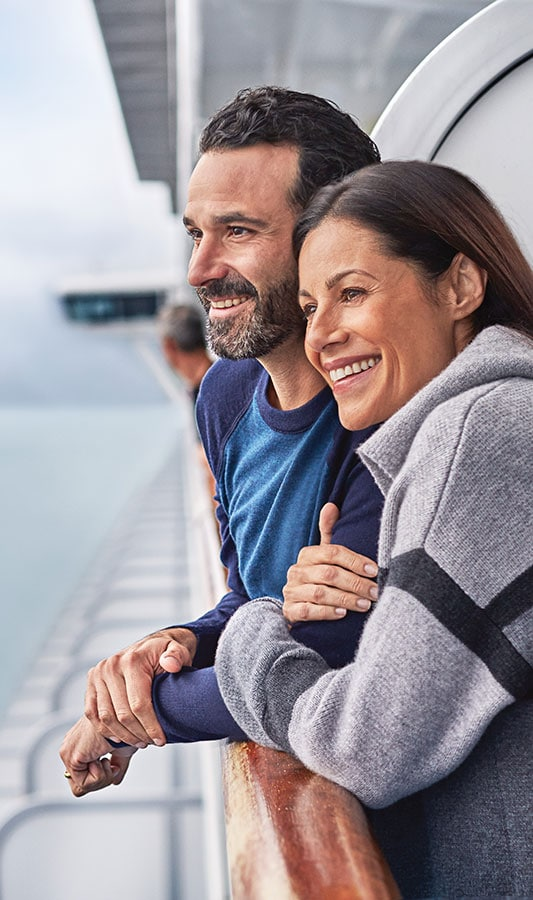 Couple onboard at the railing on an Alaska Cruise