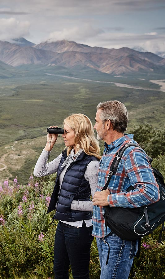 A couple exploring Denali Park on an Alaska cruisetour