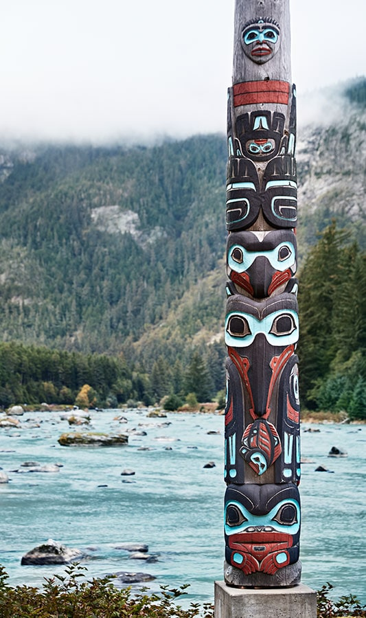 Totem pole on the bank of an Alaska stream