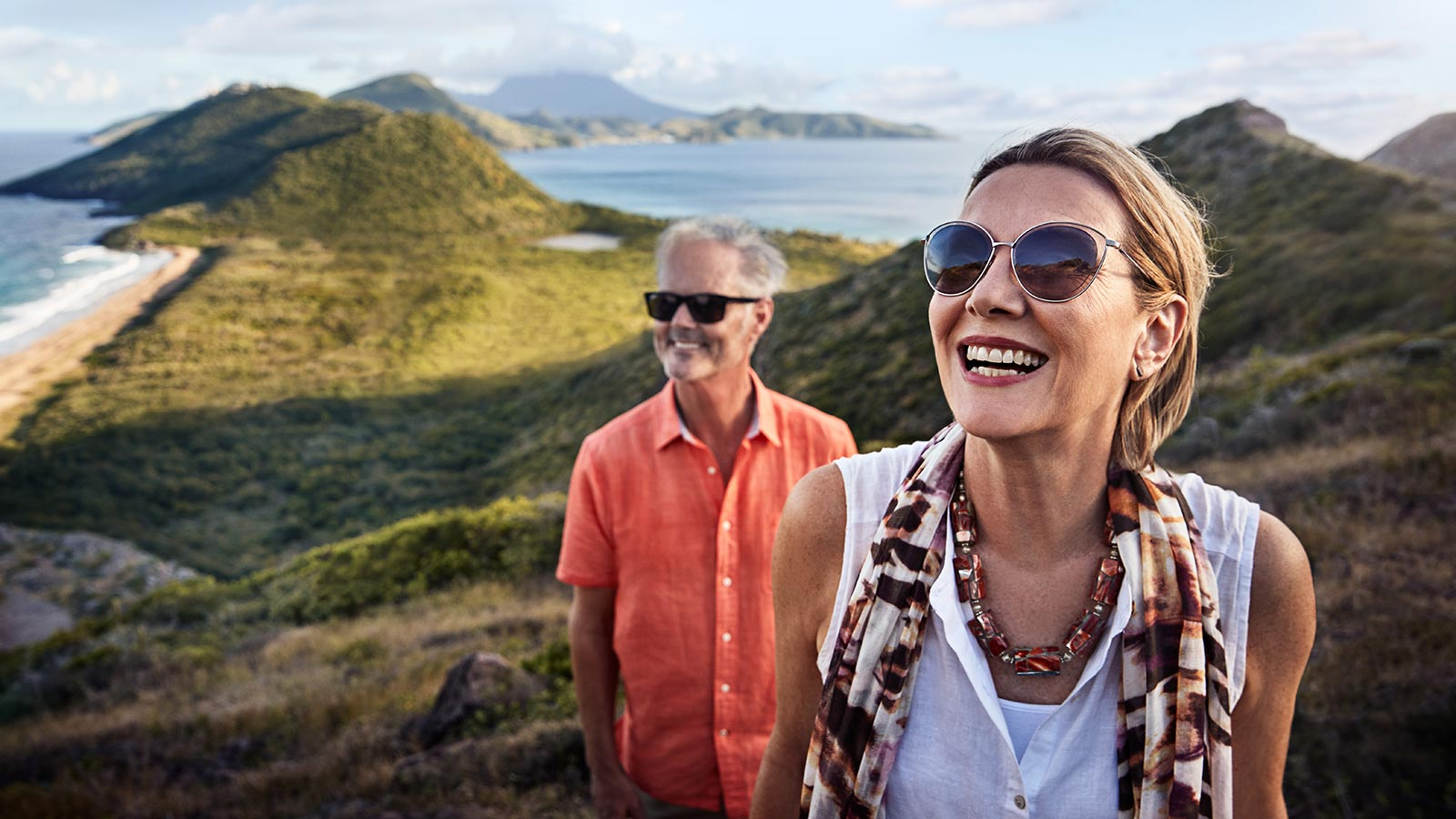 couple hiking in bluffs above shoreline