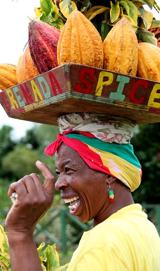 woman smiling, wearing produce filled hat