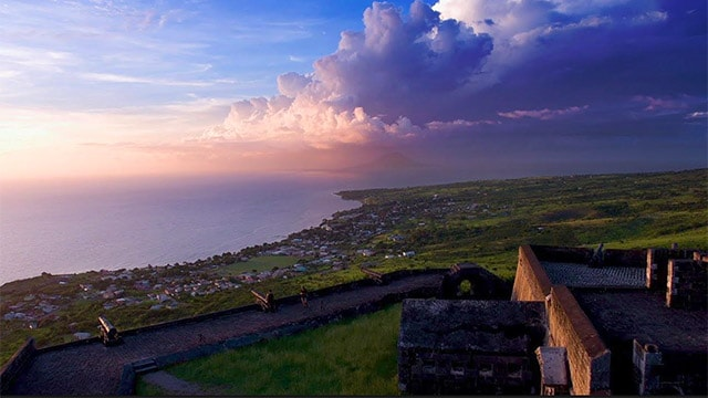 old fort by the ocean in the caribbean at sunset