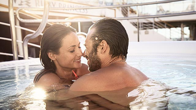 couple embracing while in the pool