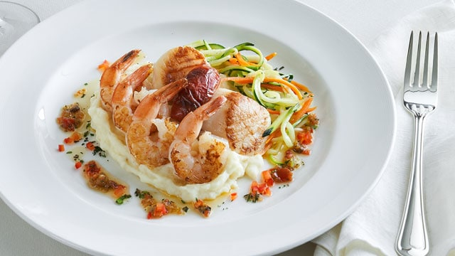 Shrimp and scallop on a bed of mashed potatoes dish served on a Princess cruise.