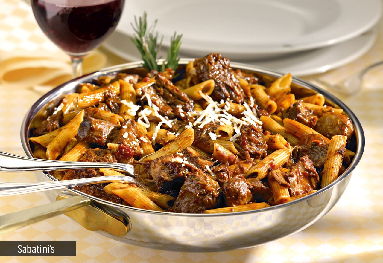 Metal pan with pene pasta and meat sauce