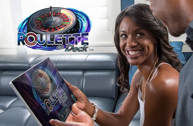 Roulette on DeckTM logo. woman holding a tablet device showing the roulette game on the screen.