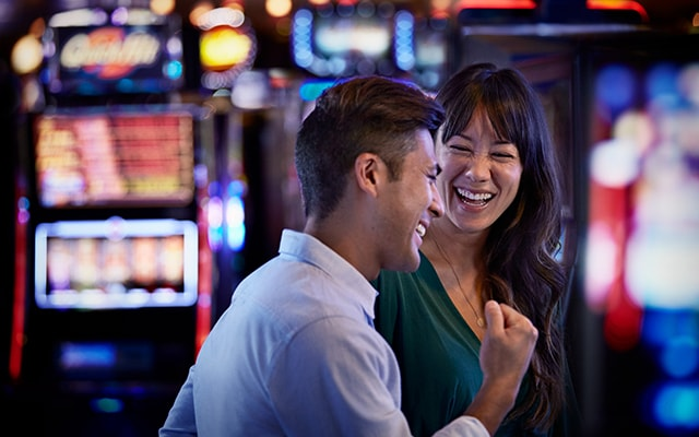 A couple happily engaged in a slot tournament
